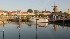 View from harbour with windmill,Wijk bij Duurstede,Netherlands Stock Footage