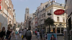 Busy shopping street with Dom church tower,Utrecht,Netherlands Stock Footage