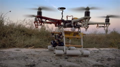 Custom drone hexacopter takes off from the field. Slow motion. Stock Footage