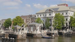Carre theater on Amstel river with locks,Amsterdam,Netherlands Stock Footage