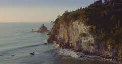 Aerial of sunrise on whangamata beach, Coromandel, New Zealand Stock Footage