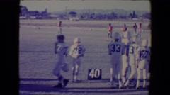 1967: Youth football game at 40 yard line.TUCSON, ARIZONA Stock Footage