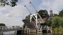 Closing of drawbridge in small town,Oudekerk,Netherlands Stock Footage