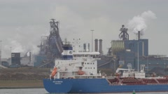 Steelworks industry with ship in river,IJmuiden,Netherlands Stock Footage