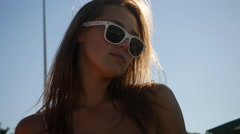 Sexy young smiling woman in sunglasses have fun on the beach Stock Footage