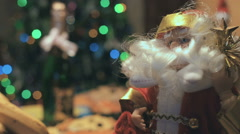 Toy Santa Under The Christmas Tree and Holiday Table Stock Footage
