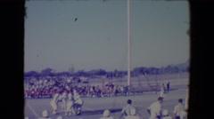 1967: A football game near a mountain region is seen.TUCSON, ARIZONA Stock Footage