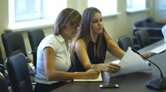 Two businesswomen at an interview considering the graphics Stock Footage