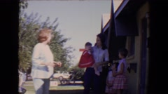 1967: A beautiful day out with the neighbors to the park to have catch Stock Footage