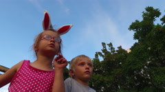 Girl with ears and glasses and boy with white hair fun talking on the background Stock Footage