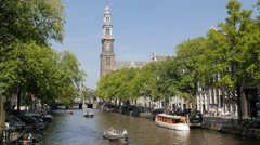 Prinsengracht canal with westerkerk tower,Amsterdam,Netherlands Stock Footage