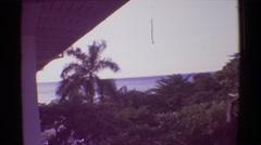 1971: a coastal area is seen with tall trees.HAWAII Stock Footage