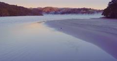 Aerial of sunrise on whangamata estuary, Coromandel, New Zealand Stock Footage