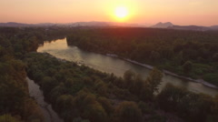 AERIAL: Beautiful wide river with tributary at magical golden light sunset Stock Footage