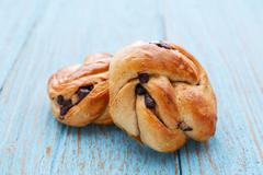 Swirl bread with chocolate chip on blue wood table Stock Photos