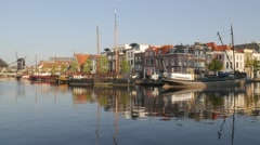 Houses along canal with reflection,Leiden,Netherlands Stock Footage