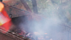 Some meat skewers being grilled in a barbecue outdoors, close up. Stock Footage