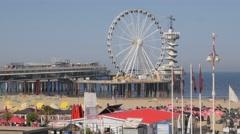 Ferris wheel and pier on beach,Scheveningen,Netherlands Stock Footage