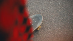 Boy in red shirt start ride skate board skateboarding Stock Footage