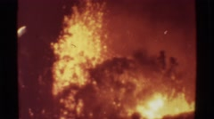 1971: Erupting volcano red molten lava searing through the earth in efforts to Stock Footage