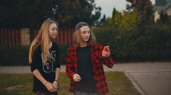 Smiling boy and girl teens posing at mobile phone for selfie Stock Footage