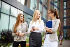 Pretty young women talking in urban environment Stock Photos