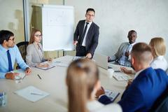 Successful businessman giving master-class for managers Stock Photos