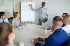 Confident businessman making presentation of statistic data Stock Photos