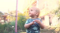 One year old baby boy jumping on trampoline. Stock Footage
