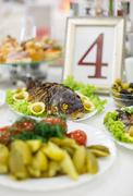 Decorated catering banquet table with different food snacks and stuffed Stock Photos
