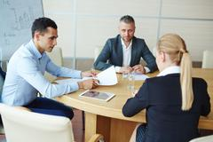 Group of co-workers communicating at educational training Stock Photos