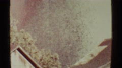 1971: volcanic eruption and ashes falling behind house as a result of Stock Footage