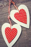 Two decorative red and white heart on a wooden background Stock Photos