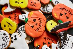Funny Hallween cookies on wooden background Stock Photos