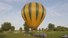 Heating up air before launch of hot air balloon,Grave,Netherlands Stock Footage