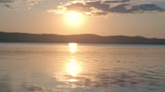 Watching Sunset over Lake Stock Footage