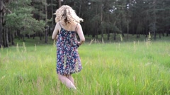 Girl resting on the nature. Beautiful girl walk on the field Stock Footage