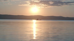 Silhouette of Kayaking Tourist at Sunset Stock Footage