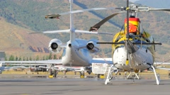 Small airport tarmac with a helicopter and a jet. Stock Footage