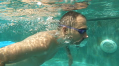 Young man swimming under water, super slow motion Stock Footage
