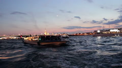 Many Boats in Water With Beautiful Evening Cityscape Stock Footage