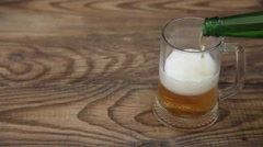 Pouring Beer Into Big Glass Stock Footage
