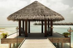 Patio or terrace with canopy on beach sea shore Stock Photos