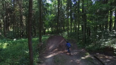 Aerial shot front view MTB BMX Trick- table top dirt jump Stock Footage