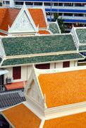 Multicolored roofs of buildings in Bangkok Stock Photos