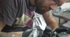 Tattoo artist working Stock Footage