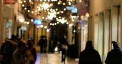 Christmas evening street in France with pedestrians walking home Stock Footage