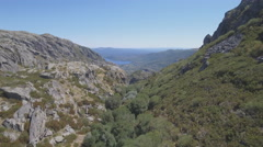 Flying over canyon towards Sanabria Lake Stock Footage