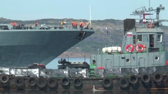 """Day of the Navy. Floats sea tugs and a large anti-submarine ship """"Severomorsk"""". Stock Footage"""