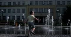 Young Boy Havin Fun Near Modern Splash Water Fountain Stock Footage